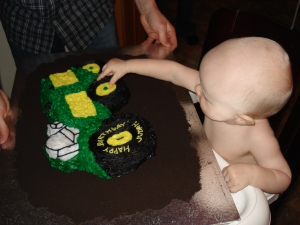 Attacking his 1st birthday cake!